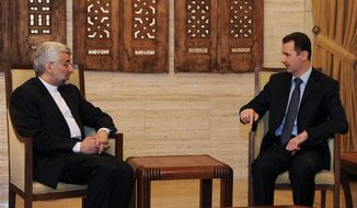 In this photo released by the Syrian official news agency, SANA, Syrian President Bashar Assad, right, meets with Iran's Chief nuclear negotiator Saeed Jalili, in Damascus, Syria, Sunday, Feb. 3, 2013. (AP Photo/SANA)