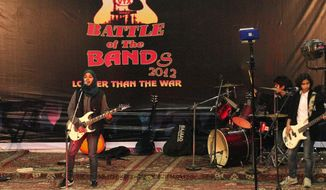 """Members of Pragaash perform at a """"Battle of the Bands"""" in Srinagar, India, where they finished third. The band disbanded after only one concert because of an edict from a top Muslim cleric. They were also called """"sluts"""" and """"prostitutes"""" who should be expelled from the region. (Associated Press)"""