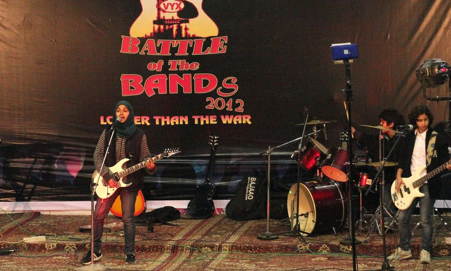 "Members of Pragaash perform at a ""Battle of the Bands"" in Srinagar, India, where they finished third. The band disbanded after only one concert because of an edict from a top Muslim cleric. They were also called ""sluts"" and ""prostitutes"" who should be expelled from the region. (Associated Press)"
