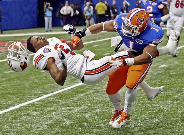 Teddy Bridgewater went on to lead Louisville to one of the biggest upset in BCS bowl history after taking a brutal hit in the Sugar Bowl on Jan. 2. The NCAA scarcely mentions concussions in its manual. (Associated Press)