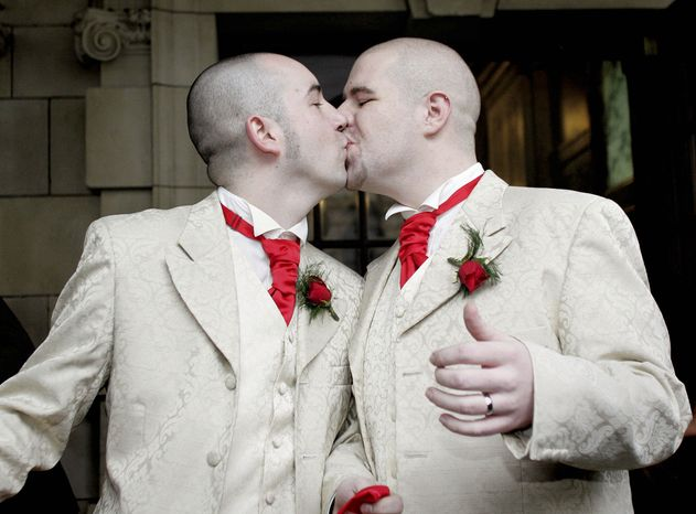 **FILE** Henry Edmont Cane (left) and partner Christopher Patrick Flanaghan kiss outside City Hall in Belfast, Northern Ireland, on Dec. 19, 2005. The two became the first male couple to win legal recognit