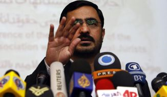 ** FILE ** In this Sunday, April 19, 2009, photo, former Tehran prosecutor Saeed Mortazavi, gestures, during a news conference, in Tehran, Iran. Mortazavi, a close ally of President Mahmoud Ahmadinejad, has been arrested, two years after a parliamentary probe found him responsible for deaths by torture of at least three jailed anti-government protesters, state media reported. (AP Photo/Vahid Salemi)