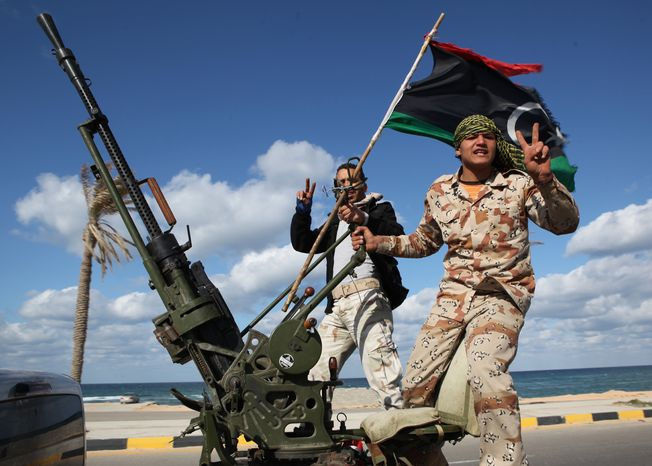 **FILE** Libyan militias from towns throughout the country's west parade through Tripoli on Feb. 14, 2012. (Associated Press)