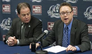 Old Dominion Director of Athletics Wood Selig, right, speaks as Old Dominion President John Broderick watches during an NCAA college basketball news conference announcing the firing of head basketball coach Blaine Taylor on Tuesday, Feb. 5, 2013, in Norfolk, Va. Associate head coach Jim Corrigan will serve as the interim coach through the remainder of the season. (AP Photo/The Virginian-Pilot, L. Todd Spencer)
