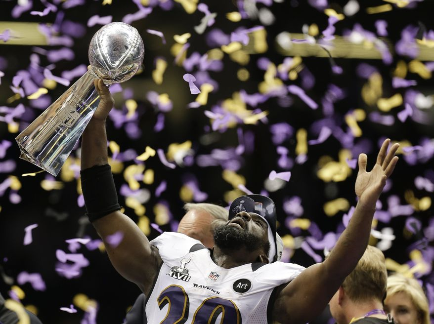 Baltimore Ravens safety Ed Reed celebrates with the Vince Lombardi Trophy after their 34-31 win against the San Francisco 49ers in the NFL Super Bowl XLVII football game, Sunday, Feb. 3, 2013, in New Orleans. (AP Photo/Julio Cortez)