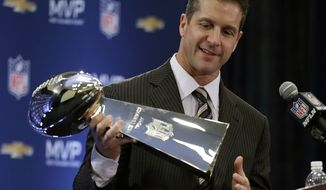 Baltimore Ravens head coach John Harbaugh holds the Vince Lombardi Trophy during a news conference in New Orleans on Feb. 4, 2013, after the Ravens' 34-31 victory over the San Francisco 49ers in Super Bowl XLVII. (AP Photo/Darron Cummings)