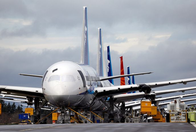 A line of new 787 Dreamliners park nose-to-tail at Paine Field in Everett, Wash., home to Boeing Inc.'s factory. The planes were grounded in January after a battery fire in one and smoke in another. (Associated Press)