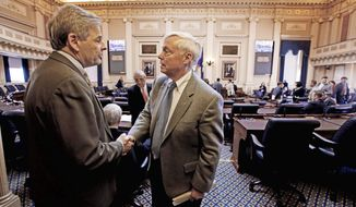 Democrats were pleased that a proposal to redraw state Senate districts died. House Minority Leader David J. Toscano, Charlottesville Democrat, (left) shakes hands with House Speaker William J. Howell, Stafford Republican, after Mr. Howell declared the redistricting bill was improper and should not be considered. (Richmond Times-Dispatch via Associated Press)