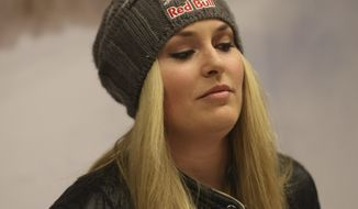 In this photo taken Sunday, Feb. 3, 2013, U.S. ski racer Lindsey Vonn attends a press conference in Schladming, Austria. Vonn crashed during the super-G at the Alpine Skiing world championships Tuesday, Feb. 5, 2013 and has been taken by helicopter to a hospital from the world championships after apparently injuring her right knee. The American lost balance on her right leg while landing after a jump. Her ski came off immediately, and Vonn slid off course and hit a gate before coming to a standstill. Vonn received medical treatment on the slope for 12 minutes before going to the hospital. (AP Photo/Luca Bruno)