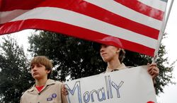 """** FILE ** Stephen Cyr (left), 13, and his brother Paul, 15, attend a """"Save Our Scouts"""" prayer vigil and rally in front of the Boy Scouts of America national headquarters in Texas on Feb. 6, 2013. (Associated Press)"""