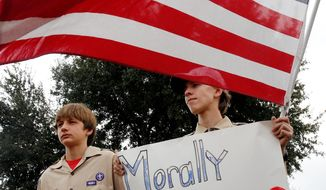 "** FILE ** Stephen Cyr (left), 13, and his brother Paul, 15, attend a ""Save Our Scouts"" prayer vigil and rally in front of the Boy Scouts of America national headquarters in Texas on Feb. 6, 2013. (Associated Press)"