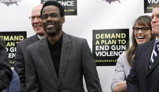 Actor and comedian Chris Rock (left), actress Amanda Peet (right) and others share a laugh during a news conference on Capitol Hill in Washington on Feb. 6, 2013, to call on Congress to act on President Obama's plan to reduce gun violence. (Associated Press)