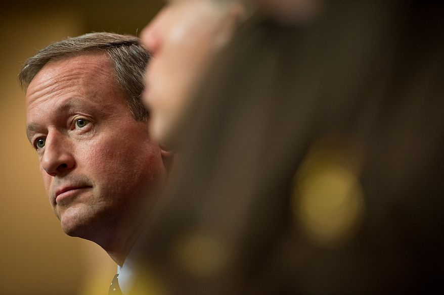 Maryland Gov. Martin O'Malley sits after testifying at a Judicial Proceedings Committee hearing to urge state lawmakers to pass legislation requiring residents to obtain a license before purchasing a handgun, ban assault weapons, limit magazine capacities to 10 rounds and require prospective gun buyers to complete a safety course and pay a $100 application fee, Annapolis, Md., Wednesday, February 6, 2013. (Andrew Harnik/The Washington Times)