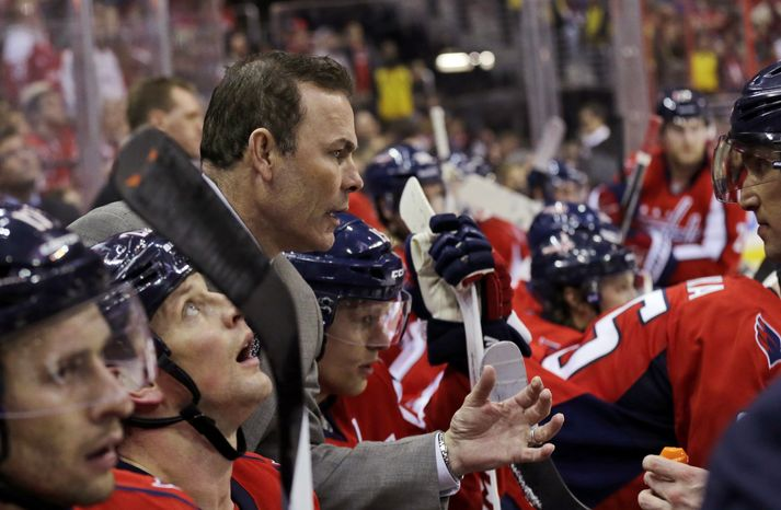 Washington Capitals coach Adam Oates leans to speak with left wing Alex Ovechkin, right, during a timeout in the third period of an NHL hockey game against the Toronto Maple Leafs on Tuesday, Feb. 5, 2013, in Washington. The Maple Leafs won 3-2. (AP Photo/Alex Brandon)