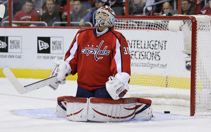 Washington Capitals goalie Michal Neuvirth reacts after a goal by Toronto Maple Leafs defenseman Korbinian Holzer during the second period of an NHL hockey game Tuesday, Feb. 5, 2013, in Washington. (AP Photo/Alex Brandon)
