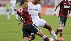 **FILE** In this Nov. 17, 2012, file photo, Nuremberg's Timothy Chandler of the U.S., left, and Bayern's David Alaba of Austria, right, challenge for the ball during the German first division Bundesliga soccer match in Nuremberg, southern Germany. Defender Timmy Chandler is set to commit his future to the Americans rather than leave open the possibility of playing for Germany. With regular right back Steve Cherundolo sidelined by a knee injury, Chandler appears likely to start Wednesday, Feb. 6, 2013, when the U.S. opens the final round of World Cup qualifying at Honduras. (AP Photo/Jens Meyer, File)