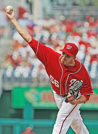 Washington Nationals relief pitcher Christian Garcia throws during a baseball game against the Miami Marlins at Nationals Park Saturday, Sept. 8, 2012, in Washington. (AP Photo/Alex Brandon)