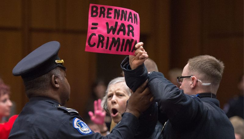 John O. Brennan answers questions from senators Thursday about drones, media leaks and other matters during his confirmation hearing to be CIA director. (Andrew Harnik/The Washington Times)