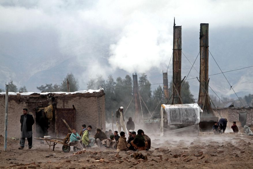 Afghan boys warm their hands over a brick-factory fire during a cold day on the outskirts of Jalalabad, Afghanistan, east of Kabul, on Monday, Feb. 4, 2013. Kabul has been experiencing below-freezing weather and snow for several days. (AP Photo/Rahmat Gul)