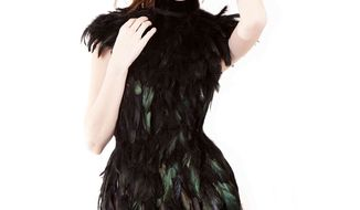 This undated image released by Christian Fashion Week shows a model wearing a black feather dress designed by Julia Chew, 18, who recently graduated after being homeschooled by her parents. Ms. Chew said her collection was inspired by nature. Christian Fashion Week will kick off Friday and Saturday, Feb. 8-9 in Tampa, Fla.  (AP Photo/Christian Fashion Week)