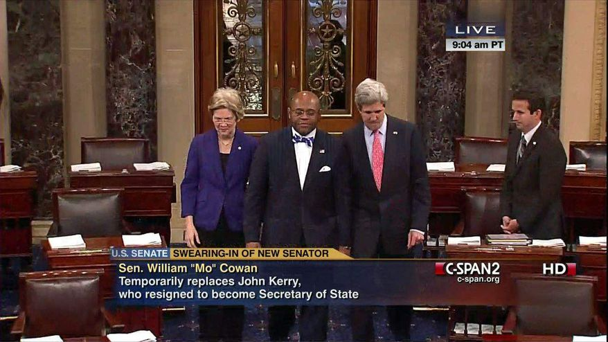 """This video frame grab image provided by C-SPAN2 shows William """"Mo"""" Cowan, center, accompanied by Sen. Elizabeth Warren, D-Mass., left, and Secretary of State John Kerry, on Capitol Hill in Washington, Thursday, Feb. 7, 2013, to officially be sworn into the Senate by Vice President Joseph R. Biden. Cowan was chosen by Massachusetts Gov. Deval Patrick to replace Kerry. (AP Photo/C-SPAN2)"""