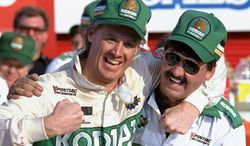 **FILE** In this Oct. 10, 1988, file photo, NASCAR driver Rusty Wallace of St. Louis, Mo., left, hugs his crew chief Barry Dodson in victory lane after winning the Oakwood Homes 500 auto race at the Charlotte Motor Speedway in Concord, N.C. Wallace, a winner of 55 races and the 1989 championship, will be inducted Friday night, Feb. 8, 2013, into the NASCAR Hall of Fame, along with Buck Baker and Herb Thomas; car owner Cotton Owens and crew chief, mechanic and engine builder Leonard Wood. (AP Photo/Robert Willett, File)