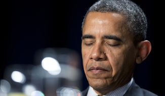 President Obama closes his eyes as he listens to offerings of prayers at the National Prayer Breakfast in Washington on Thursday, Feb. 7, 2013. While speaking, the president said he hopes to maintain the morning's bipartisan spirit a little longer. (AP Photo/Manuel Balce Ceneta)