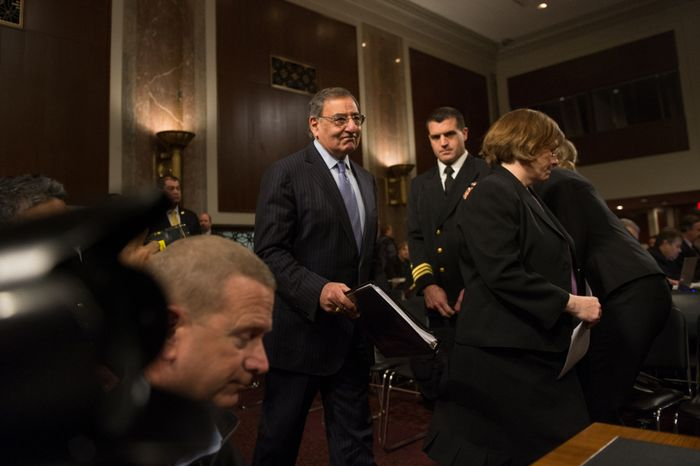 Secretary of Defense Leon E. Panetta (center) arrives to testify before the Senate Armed Services Committee on Capitol Hill in Washington on Thursday, Feb. 7, 2013, to answer questions on the Defense Department's response to the attack on U.S. facilities in Benghazi, Libya, in September. (Andrew Harnik/The Washington Times)