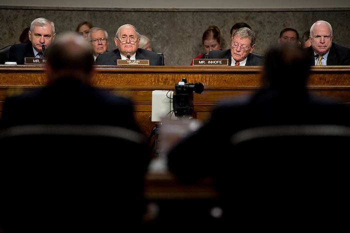 Sens. Jack Reed (left), Rhode Island Democrat; Carl Levin (third from left), Michigan Democrat and committee chairman; Jim Inhofe (third from right), Oklahoma Republican; and John McCain (right), Arizona Republican, listen as Secretary of Defense Leon E. Panetta (second from right) and Army Gen. Martin E. Dempsey (second from left), chairman of the Joint Chiefs of Staff, testify before the Senate Armed Services Committee on Capitol Hill in Washington on Thursday, Feb. 7, 2013, on the Defense Department's response to the attack on U.S. facilities in Benghazi, Libya. (Andrew Harnik/The Washington Times)