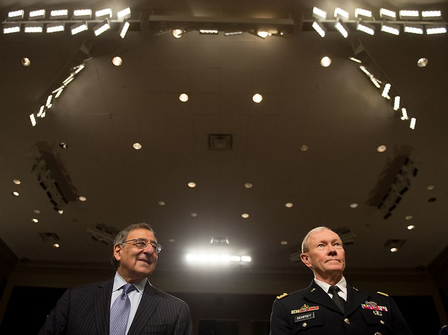 Secretary of Defense Leon E. Panetta (left) and Army Gen. Martin E. Dempsey (right), chairman of the Joint Chiefs of Staff, arrive to testify before the Senate Armed Services Committee on Capitol Hill in Washington on Thursday, Feb. 7, 2013, on the Defense Department's response to the attack on U.S. facilities in Benghazi, Libya. (Andrew Harnik/The Washington Times)