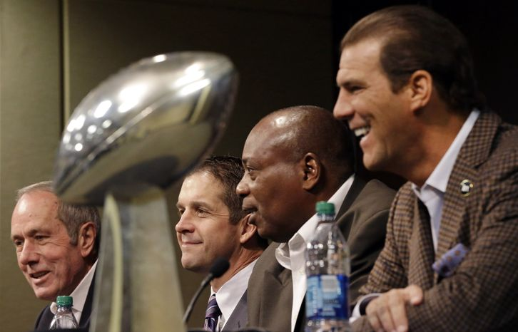 Baltimore Ravens president Dick Cass, from left, head coach John Harbaugh, general manager and executive vice president Ozzie Newsome and owner Steve Bisciotti speak alongside the Vince Lombardi Trophy at an NFL football news conference on Thursday, Feb. 7, 2013, in Owings Mills, Md. The Ravens beat the San Francisco 49ers 34-31 in Super Bowl XLVII last Sunday. (AP Photo/Patrick Semansky)
