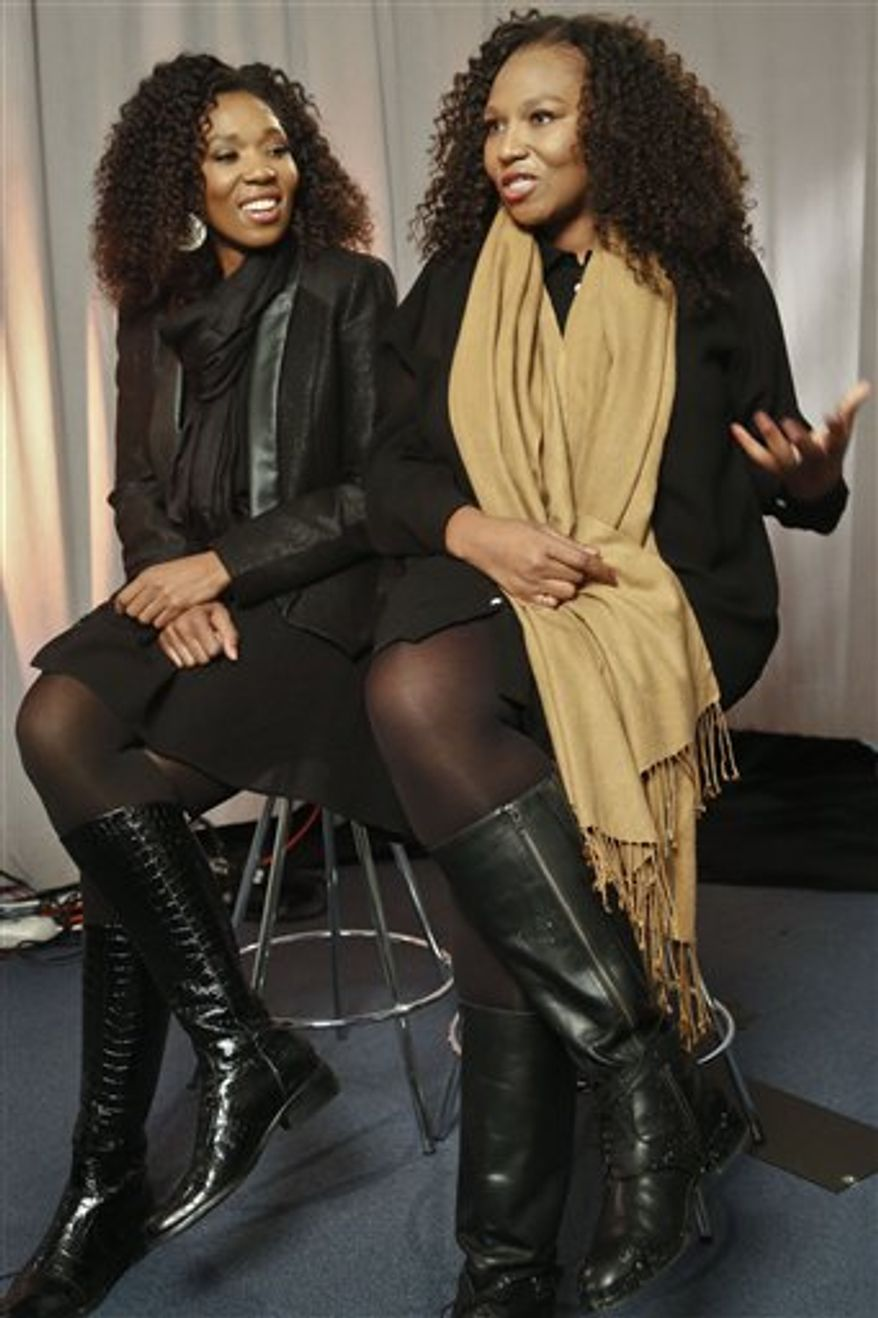 """In this Wednesday, Feb. 6, 2013 photo, Swati Dlamini, left, and Zaziwe Dlamini-Manaway, granddaughters of Nelson and Winnie Mandela, speak during an interview in New York. The sisters are stars of  the new reality show """"Being Mandela,"""" produced by COZI TV for NBC. The 30-minute weekly show premieres on Sunday, Feb. 10 at 9 PM and will follow the next generation of Mandela family through the experiences of sisters Zaziwe and Swati and their families. (AP Photo/Bebeto Matthews)"""