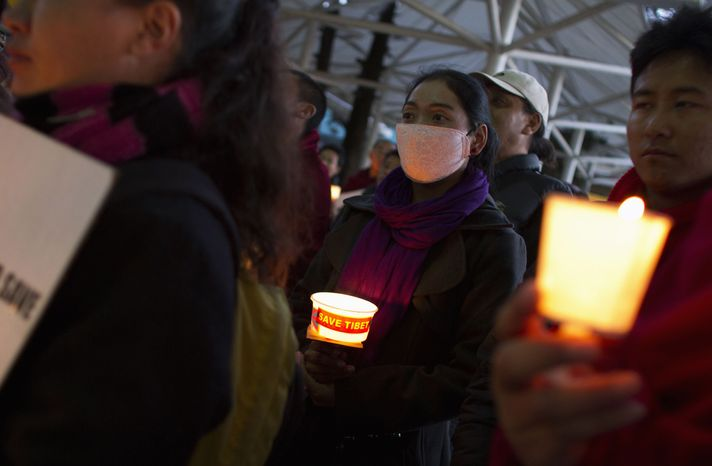 Exile Tibetans participate in a candlelit vigil organized by the Tibetan parliament-in-exile in Dharmsala, India, to show solidarity with Tibetans inside Tibet on Feb. 7, 201