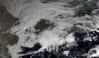This image made available by NOAA shows storm systems over the eastern half of the United States on Thursday, Feb. 7, 2013 at 11:15 EST. A blizzard of potentially historic proportions threatened to strike the Northeast with a vengeance Friday, Feb. 8, 2013, with 1 to 2 feet of snow feared along the densely populated Interstate 95 corridor from the New York City area to Boston and beyond. (AP Photo/NOAA)