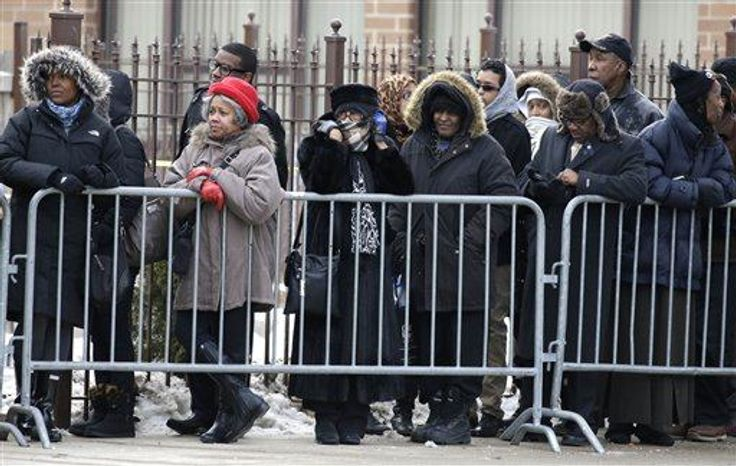Mourners wait outside the Greater Harvest Missionary Baptist Church for the funeral service of Hadiya Pendleton Saturday, Feb. 9, in Chicago. The shooting death of the 15-year-old honor student has drawn attention to the staggering gun violence in the nation's third-largest city. (Associated Press)