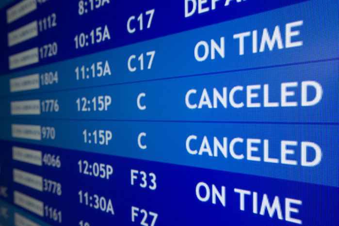 Two flights to Boston are listed as canceled at Philadelphia International Airport, Friday, Feb. 8, 2013, in Philadelphia. Airlines have already canceled more than 2,700 Friday flights as they get ready for a storm that threatens to dump up to 3 feet of snow from New York City t