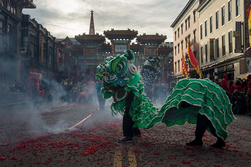 Dragons dance over fireworks on H Street in Chinatown as Washington, D.C. celebrates the Chinese New Year with a parade for the year of the snake, Washington, D.C., Sunday, February 10, 2013. (Andrew Harnik/The Washington Times)