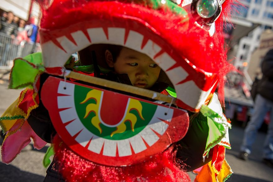 James Yuen, 4, of Germantown, Md., dress as a small dragon before Washington, D.C. celebrates the Chinese New Year with a parade down H Street in Chinatown for the year of the snake, Washington, D.C., Sunday, February 10, 2013. (Andrew Harnik/The Washington Times)