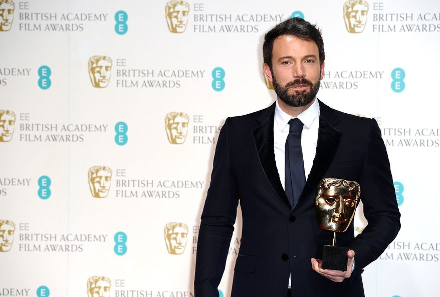 """American actor and director Ben Affleck holds the award for best film for """"Argo"""" at the BAFTA Film Awards at the Royal Opera House on Sunday, Feb. 10, 2013, in London. (Jonathan Short/Invision/AP)"""