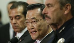 Irvine, Calif., Mayor Steven Choi (center) talks about the $1,000,000 reward for accused killer and fired Los Angeles police officer Christopher Dorner as Los Angeles Mayor Antonio Villaraigosa (left) and Los Angeles Police Chief Charlie Beck look on during a news conference at the Los Angeles Police Department headquarters on Feb. 10, 2013. (Associated Press)