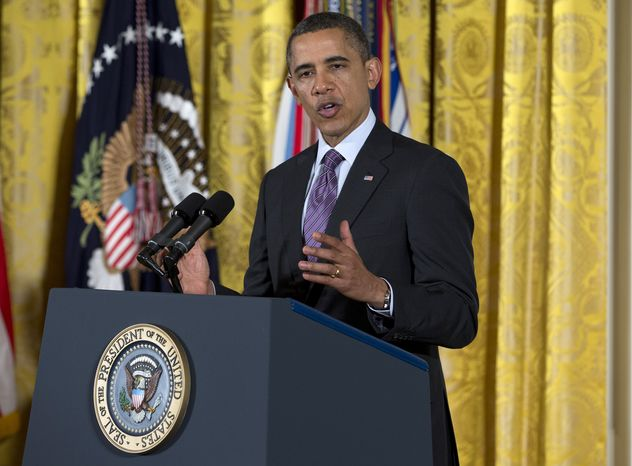 President Obama speaks in the East Room of the White House in Washington on Feb. 11, 2013, during a Medal of Honor ceremony for retired Staff Sgt. Clinton Romesha. (Associated Press)