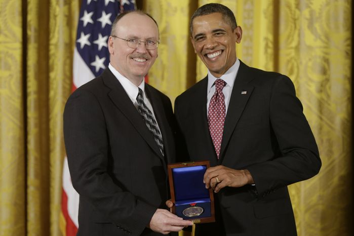 **FILE** President Obama awards the National Medal of Technology and Innovation to Raytheon BBN Technologies, accepted by CEO Edward Campbell on Feb. 1, 2013, during at a ceremony in the East Room of the White House in Washington. The awards are the highest honors bestowed by the U.S. government upon scientists, engineers, and inventors. (Associated Press)