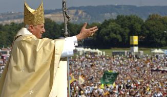**FILE** Pope Benedict XVI waves to the crowd at the end of a papal Mass in Regensburg, Germany, some 120 kilometers (about 75 miles) northeast of Munich, on Sept. 12, 2006. (Associated Press)