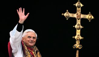 ** FILE ** This April 19, 2005, file photo shows Pope Benedict XVI greeting the crowd from the central balcony of St. Peter's Basilica moments after being elected, at the Vatican. On Monday, Feb. 11, 2013. Benedict XVI announced he would resign Feb. 28, the first pontiff to do so in nearly 600 years. The decision sets the stage for a conclave to elect a new pope before the end of March. (AP Photo/Domenico Stinellis/FILE)