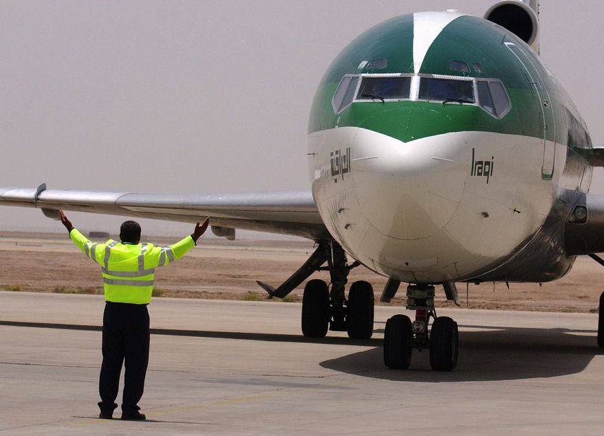**FILE** People arrive at Basra airport in Iraq on June 4, 2005, on the first commercial Iraqi Airways flight from Baghdad since Basra's airport came under British control following the fall of Saddam Hussein in 2003. (Associated Press)