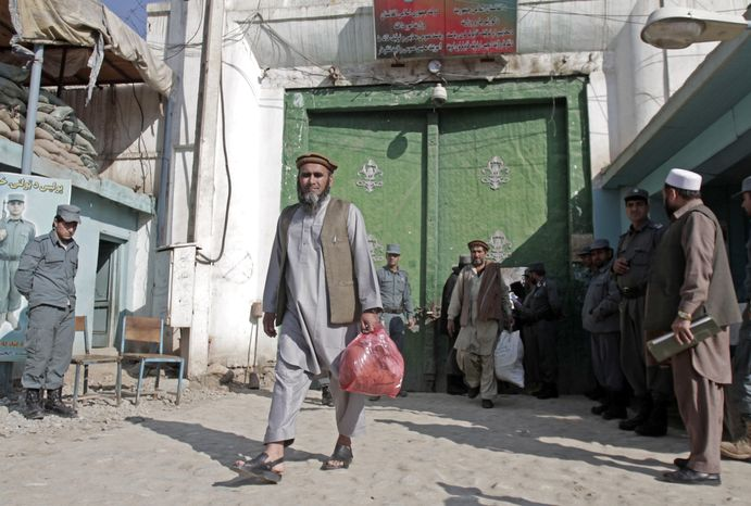 An Afghan man walks out of a prison following his early release from the Nangarhar prison in Jalalabad, east of Kabul, Afghanistan on Tuesday, Feb. 12, 2013. Around 20 Afghan prisoners were ordered to be released by decree of Afghan President Hamid Karzai to mark the birthday of Islam's Prophet Mohammed. (AP Photo/Rahmat Gul)