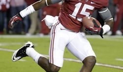 **FILE** In this Oct. 27, 2012 file photo, Alabama's Eddie Williams (15) catches a ball prior to an NCAA college football game against Mississippi State at Bryant-Denny Stadium in Tuscaloosa, Ala. Online jail records show four University of Alabama football players have been arrested on charges including credit card fraud and robbery. Records posted on the Tuscaloosa Sheriff's Department website show running back Brent Calloway was arrested Monday, Feb. 11, 2013 on a charge of fraudulent use of a credit card. Linebackers D.J. Pettway and Tyler Hayes were charged with second-degree robbery. Williams was charged with both fraudulent use of a credit card and second-degree robbery. The online records also show that Williams was arrested Sunday on a charge of carrying a pistol without a permit. (AP Photo/Dave Martin, File)