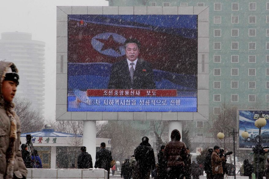 On a large television screen in front of Pyongyang's railway station, a North Korean state television broadcaster announces the news that North Korea conducted a nuclear test on Tuesday, Feb. 12, 2013. North Korea conducted a nuclear test at an underground site in the remote northeast Tuesday, taking an important step toward its goal of building a bomb small enough to be fitted on a missile that could reach United States. (AP Photo/Kim Kwang Hyon)