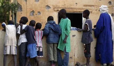 Malian children mill through the heavily shelled police station in Gao, northern Mali, Monday Feb. 11 2013, one day after Mujao fighters engaged in a firefight with Malian forces. (AP Photo/Jerome Delay)