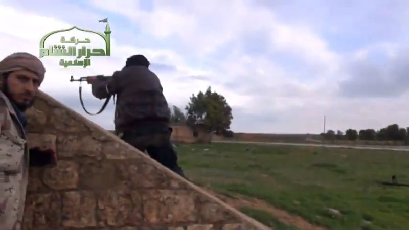 Syrian rebels are pictured at the Jarrah airfield in Syria's northern Aleppo province on Tuesday, Feb. 12, 2013, in this image taken from video and authenticated based on its contents and other A